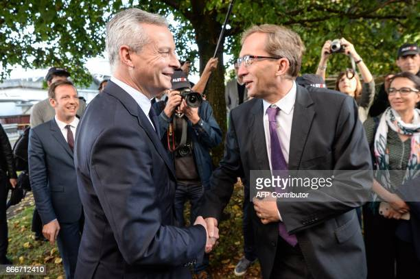 French Economy Minister Bruno Le Maire shakes hand with Alstom CIO Henri PoupartLafarge during a visit to the site of French train maker Alstom in...