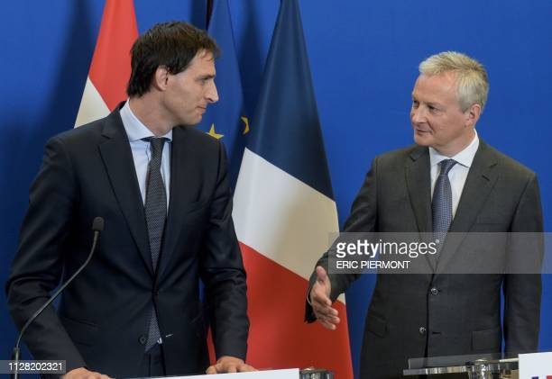 French Economy Minister Bruno Le Maire shakes hand with his Dutch counterpart Wopke Hoekstra during a press conference following their meeting at the...