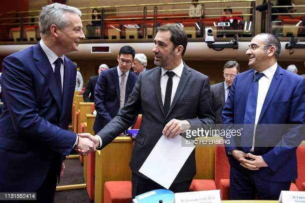 French Economy Minister Bruno Le Maire shakes hands with French Interior Minister Christophe Castaner and French Junior Minister attached to the...
