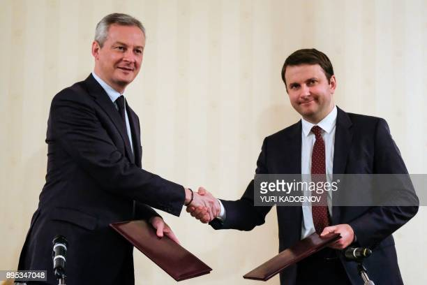 French Economy Minister Bruno Le Maire shakes hands with Russian Economy Minister Maxim Oreshkin during a signing ceremony following their meeting in...