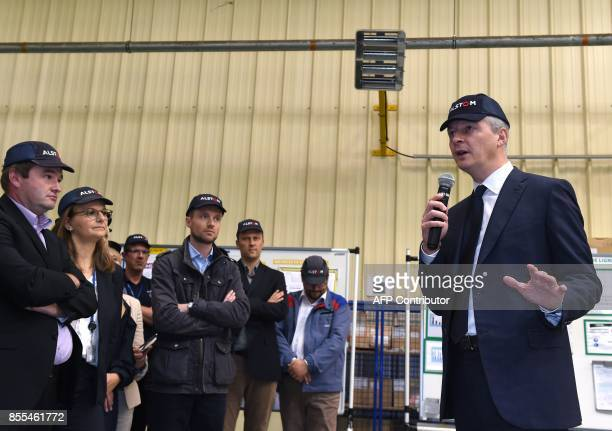 French Economy Minister Bruno Le Maire speaks in front of employees during a visit to the site of French train maker Alstom in Valenciennes northern...