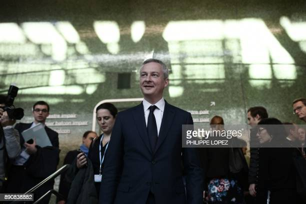 French Economy Minister Bruno Le Maire walks during the One Planet Summit on December 12 2017 at La Seine Musicale venue on l'ile Seguin in...