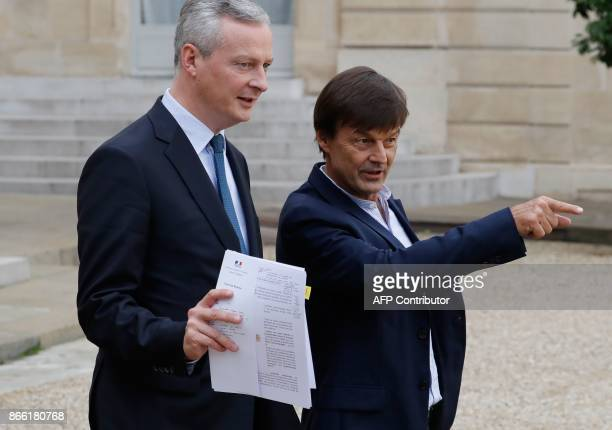 French Economy Minister Bruno Le Maire walks with French Minister for the Ecological and Inclusive Transition Nicolas Hulot after the weekly cabinet...