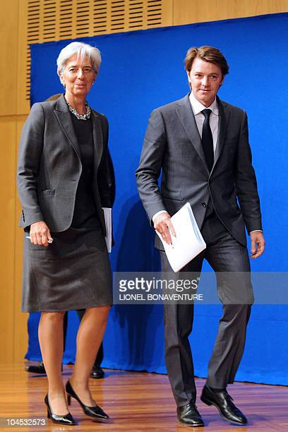 French Economy Minister Christine Lagarde and Budget minister Francois Baroin arrive prior to a press conference on September 29 2010 in Paris...