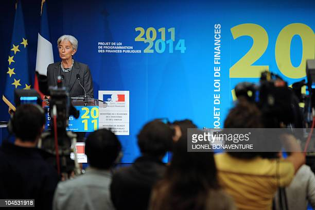 French Economy Minister Christine Lagarde delivers a speech in front of journalists during a press conference on September 29 2010 in Paris following...