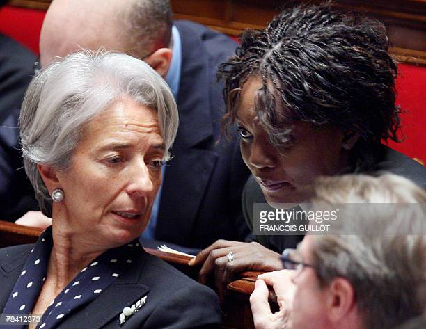 French Economy minister Christine Lagarde talks to minister of State attached to the Minister of Foreign and European Affairs responsible for Foreign...