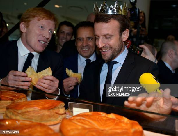 French Economy Minister Emmanuel Macron tastes a traditional Epiphany cake during a visit to the Beaugrenelle shopping centre in Paris on the first...