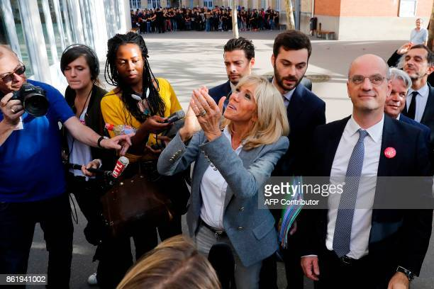 French Education Minister JeanMichel Blanquer and Brigitte Macron the wife of the French president wave as they attend the 14th edition of the a...