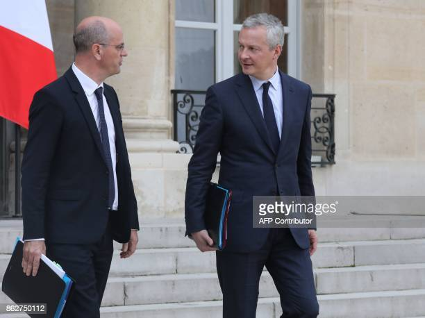 French Education Minister JeanMichel Blanquer and French Economy Minister Bruno Le Maire speak as they leave a Council of Ministers at The Elysee...
