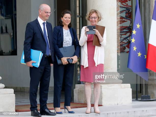 French Education Minister JeanMichel Blanquer Health and Solidarity Minister Agnes Buzyn and Labour Minister Muriel Penicaud leave following the...