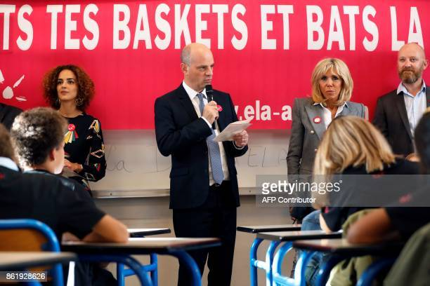 French Education Minister JeanMichel Blanquer speaks flanked by Brigitte Macron the wife of the French president and FrenchMoroccan writer Leila...
