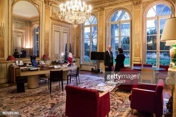French Education minister JeanMichel Blanquer speaks with a member of his staff at the ministry on January 18 2018 in Paris / AFP PHOTO / JOEL SAGET