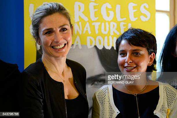 French Education Minister Najat VallaudBelkacem and French actress Julie Gayet pose after signing the first partnership convention between the...