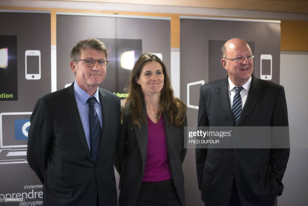 French Education Minister Vincent Peillon, Minister for Culture and Communication Aurelie Filippetti, and French state owned television group France Television's director Remy Pflimlin pose after a press conference to launch the group's new website 'francetveducation,' on November 19, 2012 at France Télévision headquarters in Paris.