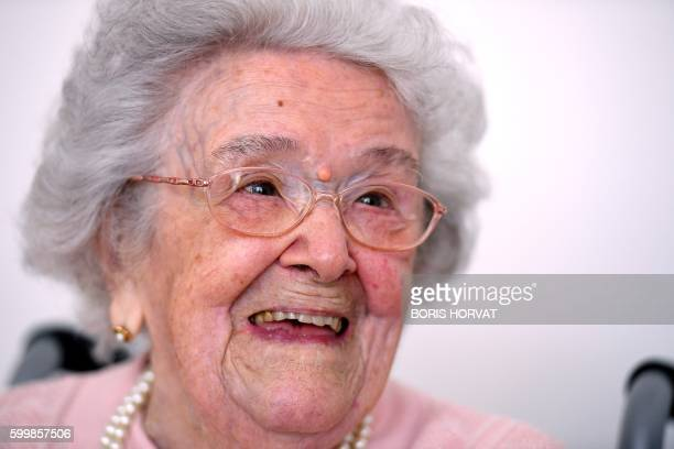French eldest person Honorine Rondello 113 years old smiles on September 7 2016 at the retirement home where she lives in SaintMaximinLa SainteBaume...