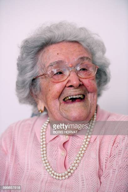 French eldest person Honorine Rondello, 113 years old, smiles on September 7, 2016 at the retirement home where she lives in Saint-Maximin-La...