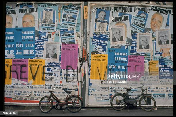 French election posters pasted on building wall exterior with names of candidates Georges Pompidou and Jacques Duclos most prominent