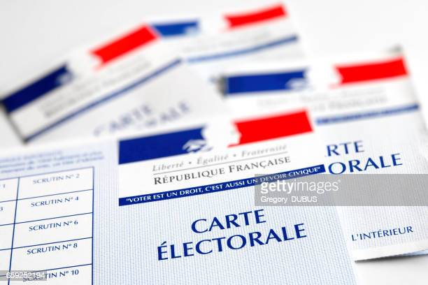 french electoral voter cards official government allowing to vote paper close-up placed on white bright table - election stock pictures, royalty-free photos & images