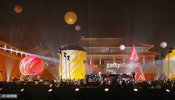 French electronic music artist JeanMichel Jarre performs a concert in the Forbidden City on October 10 2004 in Beijing China It is Jarre's first...