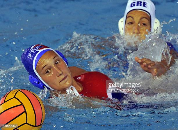 French Elise Lefert fights for the ball with Greek Sofia Iosifidou in the aquatic centre swimming pool of Spanish town Malaga on July 5 2008 during a...
