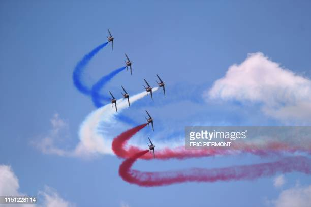 """French elite acrobatic flying team """"Patrouille de France"""" perform a flying display at the International Paris Air Show on June 21 at Le Bourget..."""