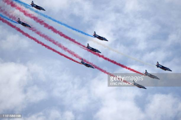 """French elite acrobatic flying team """"Patrouille de France"""" performs a flying display on the last day of the International Paris Air Show at Le Bourget..."""