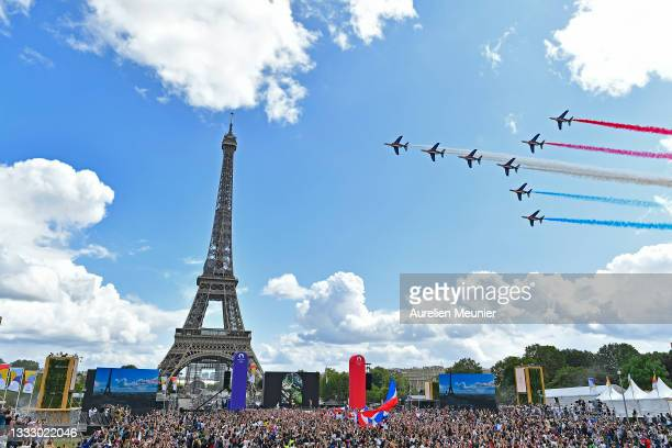 French Elite acrobatic team Patrouille de France flyes over the Eiffel Tower during the Olympic Games handover ceremony on August 08, 2021 in Paris,...