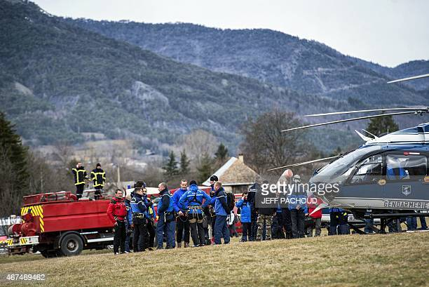 French emergency services workers and members of the French gendarmerie gather in Seyne southeastern France on March 25 prior to resume the search...