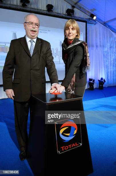 French energy giant Total chief executive Christophe de Margerie and French junior minister for ecology and sustainable development Valerie Letard...
