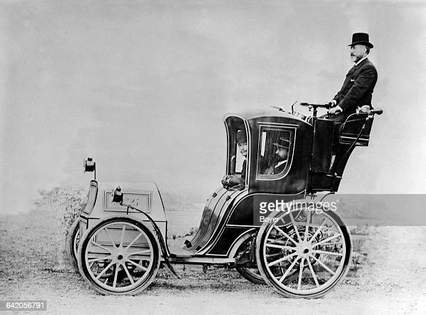 French engineer Charles Jeantaud driving the Jeantaud Cab number 25 an electric vehicle of his own invention circa 1898 His passengers are Count...