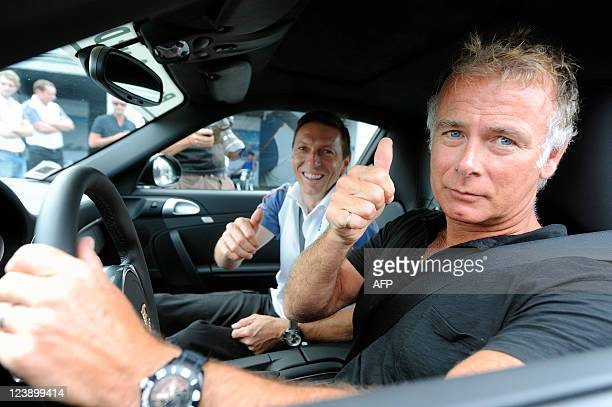 French entertainer Franck Dubosc thumbs up next to professional driver Christophe Tinseau in a Porsche Carrera 4 GTS on September 1 2011 on the Le...