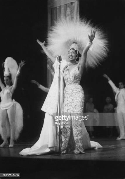 French entertainer Josephine Baker wears a headdress of 4000 feathers for a rehearsal of her new revue 'Paris Mes Amours' at the Olympia Theatre in...