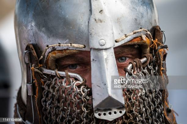 French enthusiast wearing an armour prepares for a fight during the medieval tournament Battle of the Nations at the Smederevo fortress in eastern...