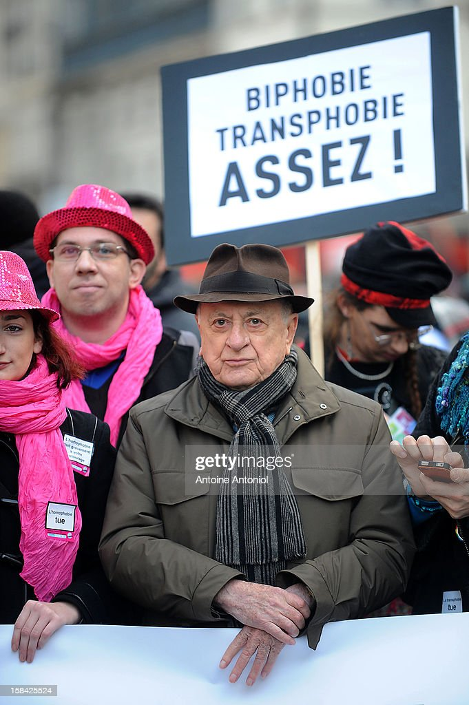 French entrepreneur and co-founder of the Yves Saint Laurent designer house Pierre Berger (C) demonstrates for the legalisation of gay marriage and parenting on December 16, 2012 in Paris, France. Demonstrations have shown a deep division in French society over the marriage equality bill expected to be passed in early 2013. The bill would not only legalize same-sex marriage but would also allow gay couples to adopt, which is seen as the most controversial issue. French President Francois Hollande, who has supported the legislation, is facing criticism from anti-gay and religious groups, while gay rights groups have warned of inadequacies within the bill.
