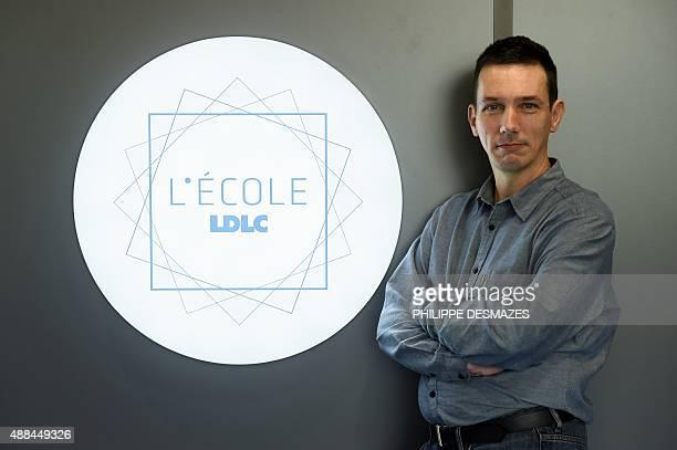 French entrepreneur Laurent de la Clergerie founder of computer retailer website LDLCcom poses beside the logo of his new school for digital...