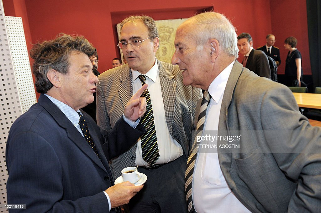 French Environment Jean-Louis Borloo speaks with the president of the Corsica executive council Paul Giacobbi (C) and the president of Corsica' Assembly Dominique Bucchini on June 15, 2010 in Ajaccio on the French Mediterranean island of Corsica prior to a visit in Sardaigna. Borloo and his Italian counterpart Stefania Prestigiacomo are due to ask the UN to forbid the transit of ships carrying hazardous material in the mouths of Bonifacio.