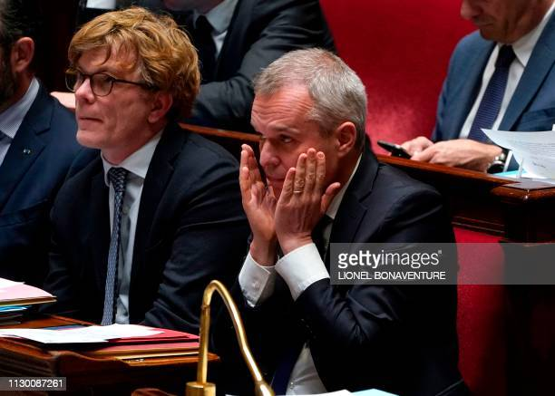 French Environment Minister Francois de Rugy gestures during a session of questions to the government at the National Assembly in Paris on March 12...