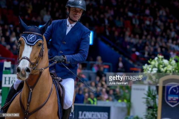 French equestrian Cedric Angot on Talent des Moltiers rides in the Accumulator Show Jumping Competition during the Gothenburg Horse Show in...