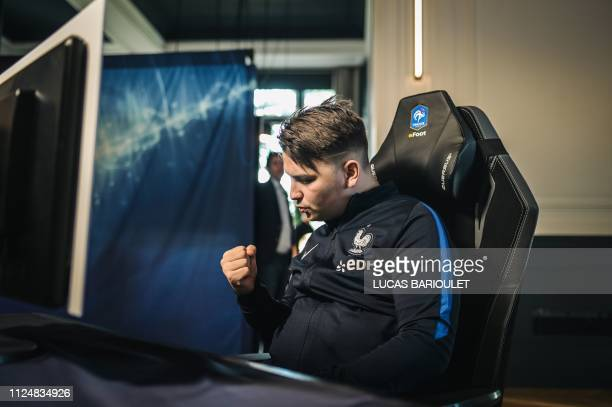"""French E-sport pro gamer Corentin Thullier """"Maestro"""" reacts during the French national efoot selection 2019, designating the 6 best French FIFA..."""