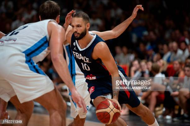 French Evan Fournier controls the ball during the warmup basketball match between France and Argentine prior to the World Cup on August 17 at the...