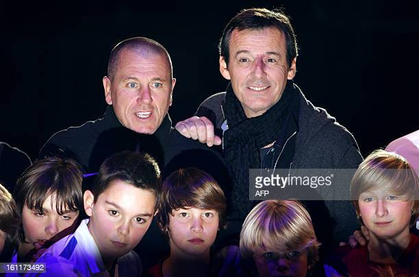 French exfootball player Pascal Olmeta and French television host JeanLuc Reichmann pose for photographers during the Show Beach Soccer Celebrities'...