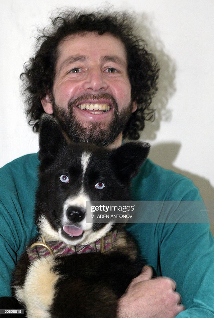French explorer Gilles Elkaim shows to the journalists one of his polar dogs during a press conference in Moscow, 20 May 2004. For the first time in history of polar exploration Gilles Elkaim crossed alone the entire Eurasian Arctic. It took four years and 12 000 kms for Elkaim to cross from the Atlantic to the Pacific.