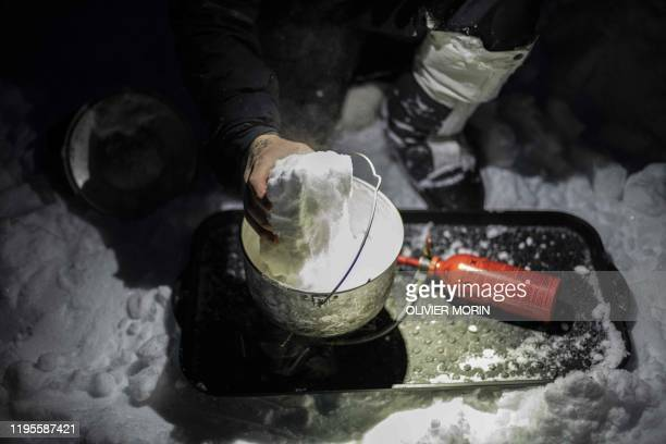 French explorer Loury Lag melts snow on January 14 in Alta Finnmark region in northern Norway during a training to prepare an expedition of 130 days...