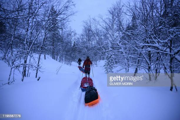 TOPSHOT French explorers at ski Matthieu Bellanger and Loury Lag train in Alta Finnmark Region Northern Norway on January 14 ahead of an expedition...