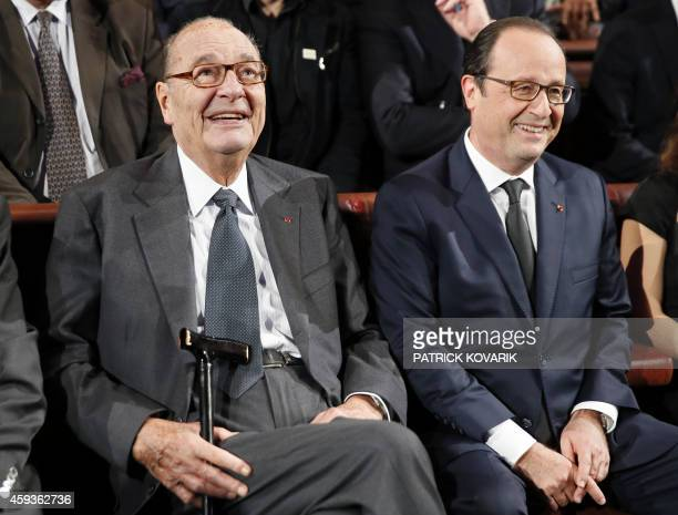 French expresident Jacques Chirac listens to French President Francois Hollande during the award ceremony of the Jacques Chirac Foundation on...