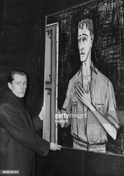 French Expressionist painter Bernard Buffet with a 1956 selfportrait at a gallery in the Rue de Faubourg SaintHonoré Paris France 17th January 1958