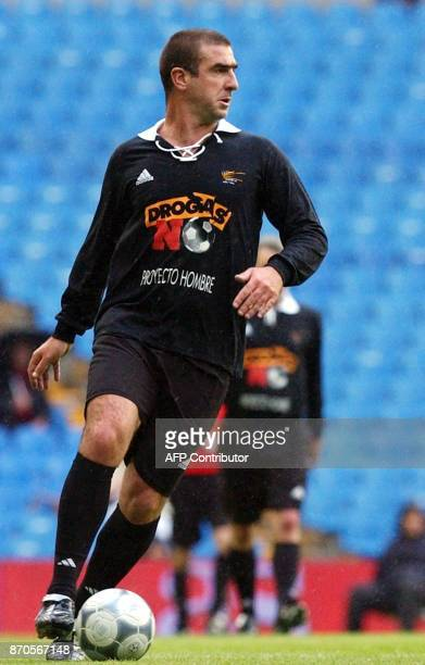 French exsoccer star Eric Cantona participates in a 'match against drugs' with Real Madrid and other veteran soccer players in Madrid 07 May 2002 AFP...