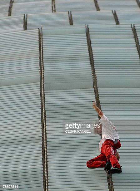 French extreme climber Alain Robert scales the Agbar Tower the new symbol of Barcelona designed by French architect Jean Nouvel in Barcelona 12...