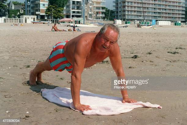 French extremeright National Front leader JeanMarie Le Pen does pushups after a swim 02 September 1994 in La Baule beach resort AFP PHOTO FRANK PERRY...