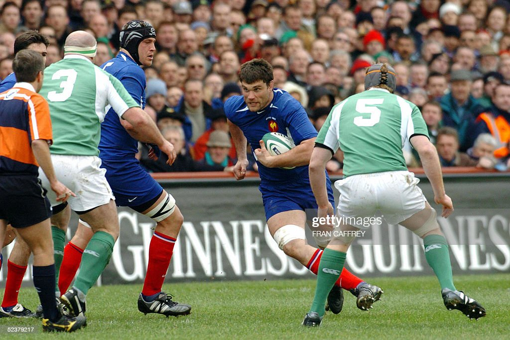 French Fabian Pelous breaks through the Irish defence 12 March 2005 during their Six nations match at Lansdowne Road in Dublin. France won 26-19 AFP/NEWSFILE/FRAN CAFFREY. (Photo credit should read